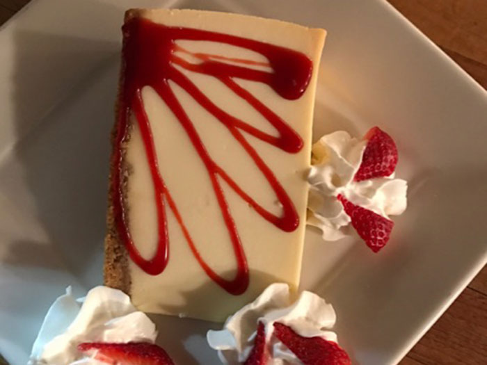 NEW YORK CHEESECAKE w/ STRAWBERRY SAUCE